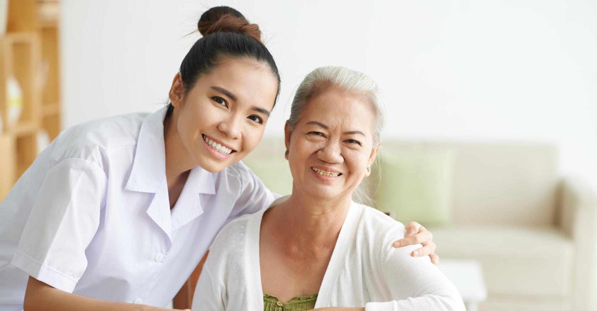 Caregiver and Senior Women smiling