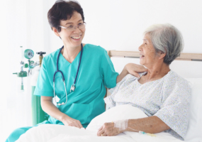 Senior nurse take care elderly woman in room of hospital