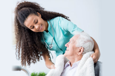 smiling elder woman with her caregiver